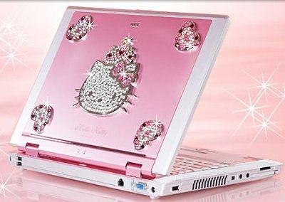 Różowy laptop z kello kity