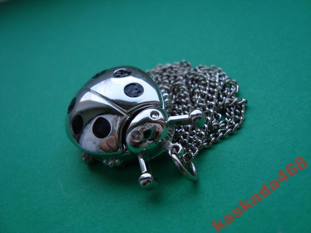 Medalion z zegarkiem * ŻUCZEK *