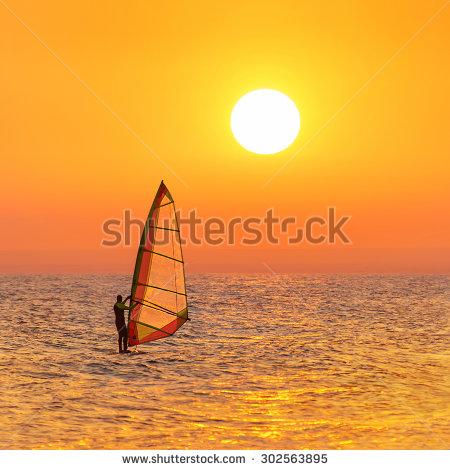 Obraz windsurfing o zachodzie słońca