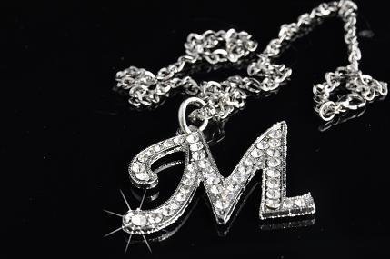 Wisiorek srebrny z literką M, np.